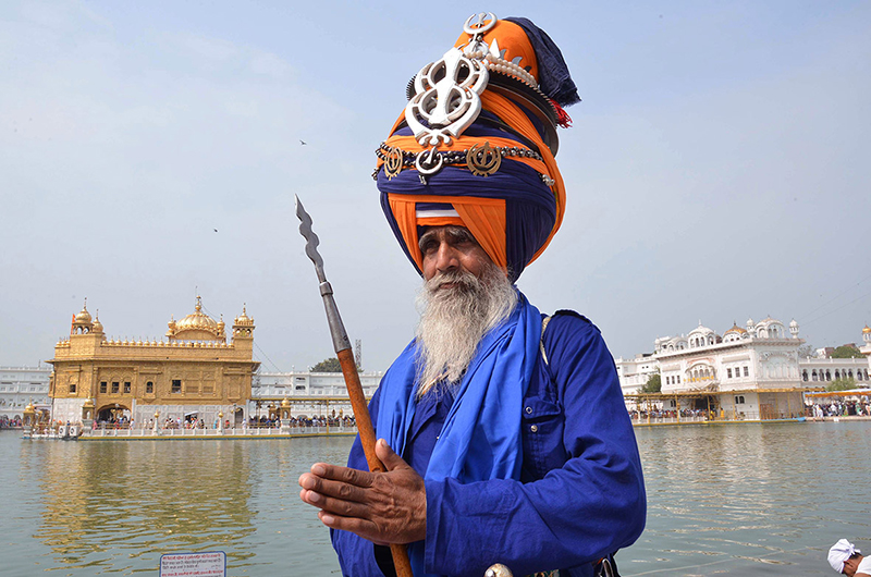 A Nihang (Sikh religious warrior) pays his respects at the Golden Temple in Amritsar